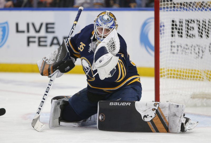 Buffalo Sabres goalie Linus Ullmark (35) makes a glove save during the second period of an NHL hockey game against the Tampa Bay Lightning, Saturday, Jan. (AP Photo/Jeffrey T. Barnes)
