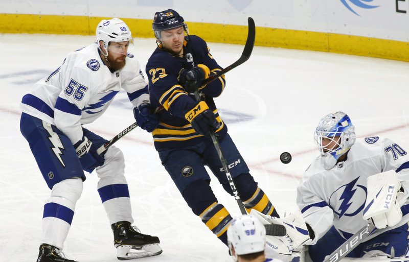 Buffalo Sabres forward Sam Reinhart (23) and Tampa Bay Lightning forward Braydon Coburn (55) battle for the puck during the first period of an NHL hockey game, Saturday, Jan. (AP Photo/Jeffrey T. Barnes)
