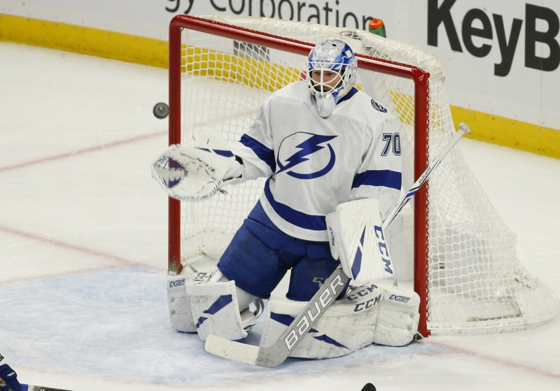 Tampa Bay Lightning goalie Louis Domingue (70) makes a save during the first period of an NHL hockey game against the Buffalo Sabres, Saturday, Jan. (AP Photo/Jeffrey T. Barnes)