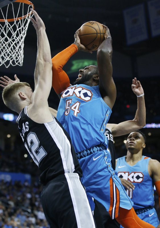 Oklahoma City Thunder forward Patrick Patterson (54) shoots as San Antonio Spurs forward Davis Bertans (42) defends in the first half of an NBA basketball game in Oklahoma City, Saturday, Jan. (AP Photo/Sue Ogrocki)