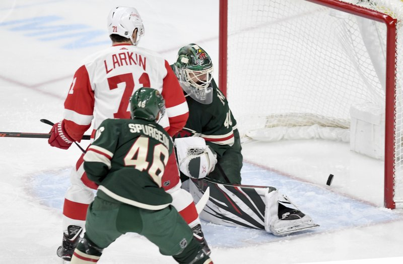 Minnesota Wild goalie Devan Dubnyk, left, Detroit Red Wings' Dylan Larkin (71) and Wild's Jared Spurgeon (46) watch the goal of the Detroit Red Wings' Gustav Nyquist, of Sweden, go into the net in the first period of an NHL hockey game Saturday, Jan. (AP Photo/Tom Olmscheid)