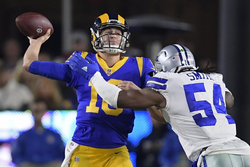 Los Angeles Rams quarterback Jared Goff passes under pressure from Dallas Cowboys middle linebacker Jaylon Smith during the first half in an NFL divisional football playoff game Saturday, Jan. (AP Photo/Mark J. Terrill)