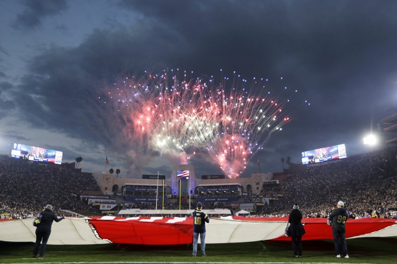 Fireworks explode over the field before an NFL divisional football playoff game between the Los Angeles Rams and the Dallas Cowboys, Saturday, Jan. (AP Photo/Jae C. Hong)