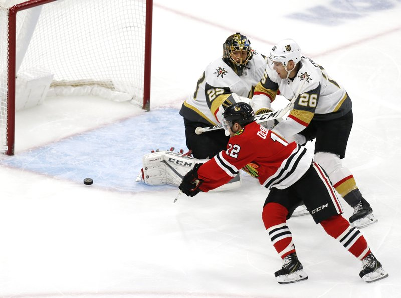 Chicago Blackhawks left wing Alex DeBrincat (12) slips the puck past Vegas Golden Knights goaltender Marc-Andre Fleury (29) for a goal during the first period of an NHL hockey game Saturday, Jan. (AP Photo Nuccio DiNuzzo)