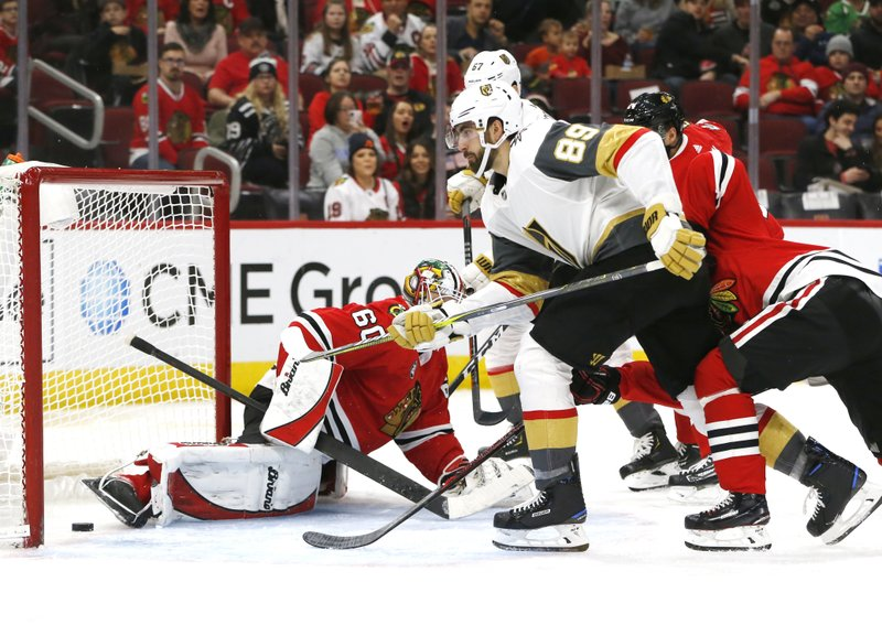 Vegas Golden Knights right wing Alex Tuch (89) scores a goal past Chicago Blackhawks goaltender Collin Delia (60) during the second period of an NHL hockey game Saturday, Jan. (AP Photo Nuccio DiNuzzo)