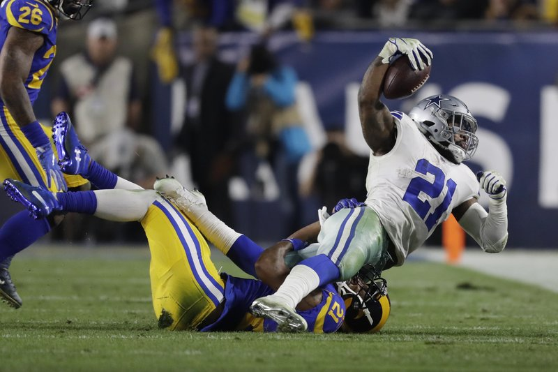 Dallas Cowboys running back Ezekiel Elliott is tackled by Los Angeles Rams cornerback Aqib Talib during the first half in an NFL divisional football playoff game Saturday, Jan. (AP Photo/Marcio Jose Sanchez)