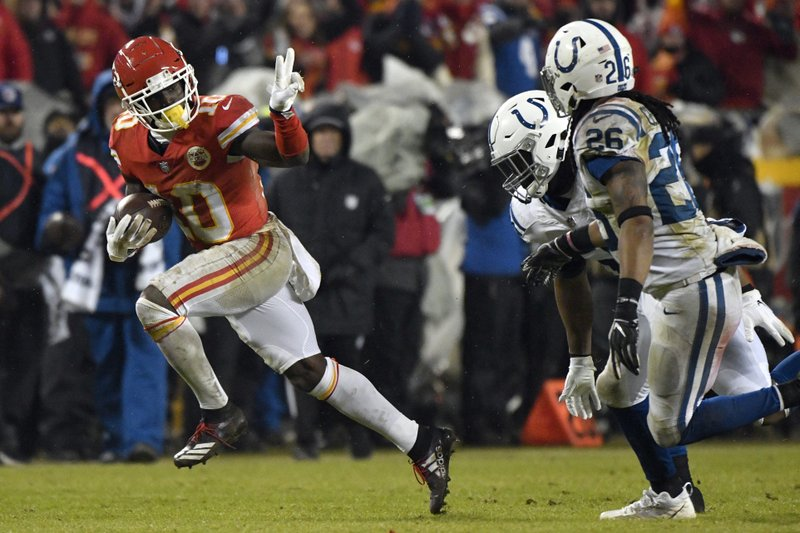 Kansas City Chiefs wide receiver Tyreek Hill (10) gestures as he runs past Indianapolis Colts safety Clayton Geathers (26) and linebacker Anthony Walker during the second half of an NFL divisional football playoff game in Kansas City, Mo. (AP Photo/Ed Zurga)