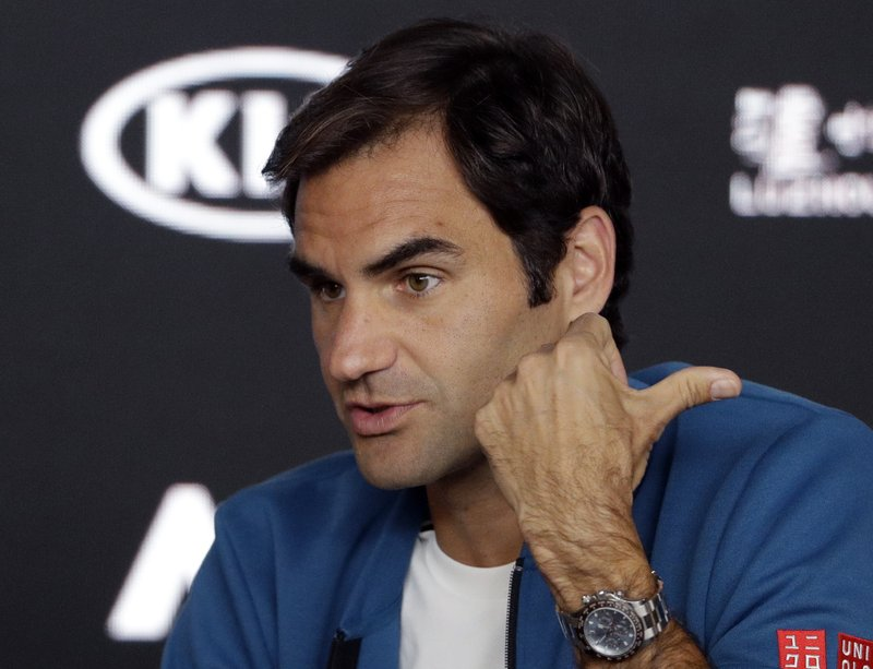 Men's defending singles champion Switzerland's Roger Federer answers a question during a press conference at the Australian Open tennis championships in Melbourne, Australia, Sunday, Jan. (AP Photo/Mark Schiefelbein)