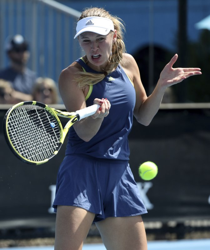 Denmark's Caroline Wozniacki makes a forehand return during a practice session ahead of the Australian Open tennis championships in Melbourne, Australia, Saturday, Jan. (AP Photo/Mark Schiefelbein)