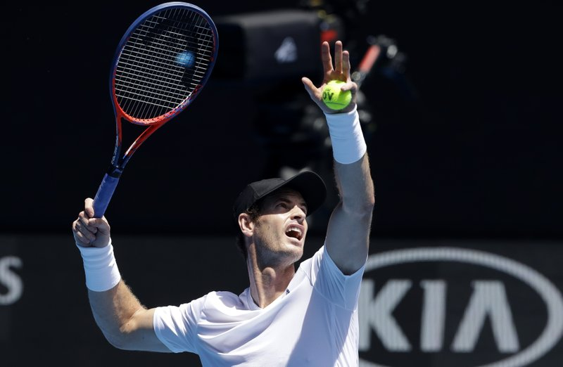 Britain's Andy Murray prepares to hit the ball during practice session ahead of the Australian Open tennis championships in Melbourne, Australia, Saturday, Jan. (AP Photo/Kin Cheung)