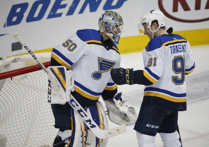 St. Louis Blues goaltender Jordan Binnington (50) and right wing Vladimir Tarasenko (91) congratulate each other after the Blues defeated the Dallas Stars 3-1 during an NHL hockey game in Dallas, Saturday, Jan. (AP Photo/Michael Ainsworth)