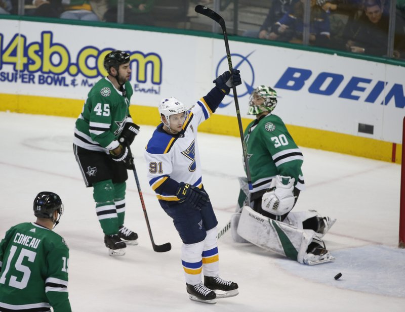 St. Louis Blues right wing Vladimir Tarasenko (91) celebrates his power-play goal in front of Dallas Stars defenseman Roman Polak (45) and goaltender Ben Bishop (30) during the third period of an NHL hockey game in Dallas, Saturday, Jan. (AP Photo/Michael Ainsworth)