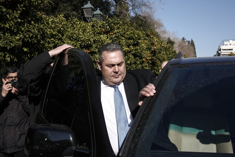 Greek Defense Minister Panos Kammenos, leaves Maximos mansion following a meeting with Greece's Prime Minister Alexis Tsipras, in Athens, Sunday, Jan. (AP Photo/Yorgos Karahalis)