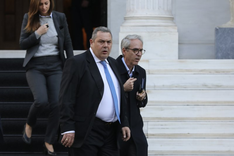 Greek Defense Minister Panos Kammenos leaves Maximos mansion following a meeting with Greece's Prime Minister Alexis Tsipras, in Athens, Sunday, Jan. (AP Photo/Yorgos Karahalis)