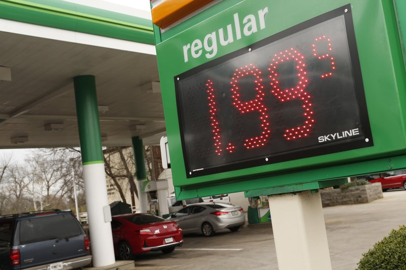 FILE - In this Tuesday, Jan. 8, 2019, file photo drivers fill up at the BP station on Prince Avenue in Athens, Ga. (3.8 liters) over the past three weeks to $2.31. Industry analyst Trilby Lundberg of the Lundberg Survey says Sunday, Jan. 13, that falling crude oil costs are the main reason for the decrease at the pump. The average gas price has dropped 66 cents over the past 3 ½ months. The highest average price in the nation is $3.46 a gallon in the San Francisco Bay Area. The lowest average is $1.80 in Baton Rouge, Louisiana. (Joshua L. Jones/Athens Banner-Herald via AP, File)