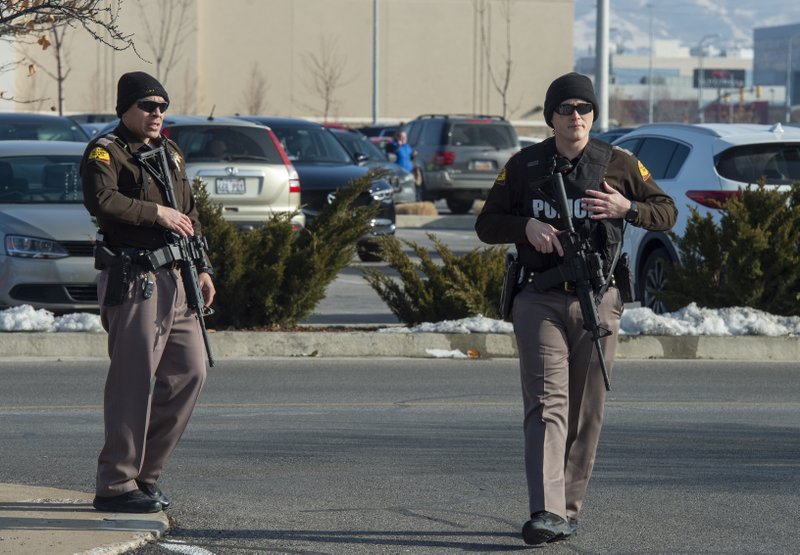 Police patrol the parking lot at Fashion Place Mall in Murray, Utah, after a shooting at Sunday, Jan. (Rick Egan/The Salt Lake Tribune via AP)