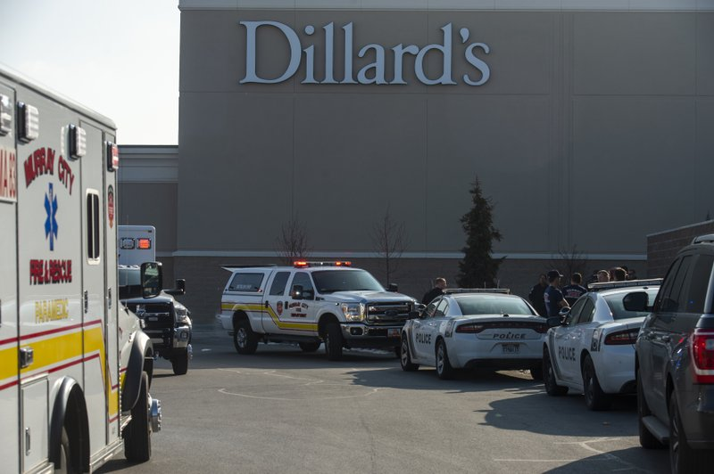 Shoppers are evacuated from Fashion Place Mall in Murray, Utah, after a shooting on Sunday, Jan. 13, 2019. (Rick Egan/The Salt Lake Tribune via AP)