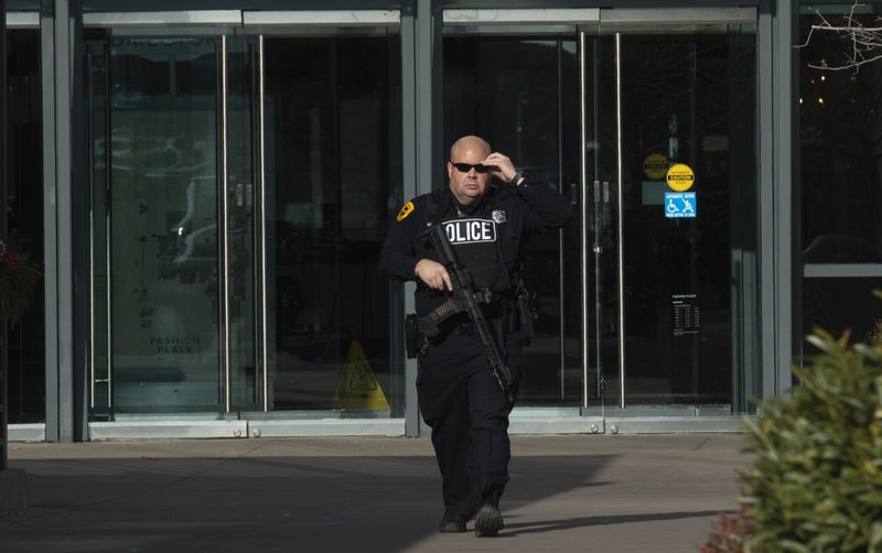 Police clear everyone out of the Fashion Place Mall in Murray, Utah, after a shooting at Sunday, Jan. (Rick Egan/The Salt Lake Tribune via AP)