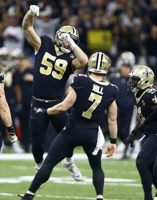 New Orleans Saints quarterback Taysom Hill (7) celebrates his first down carry on a fake punt, with linebacker Vince Biegel (59) in the first half of an NFL divisional playoff football game in New Orleans, Sunday, Jan. (AP Photo/Butch Dill)