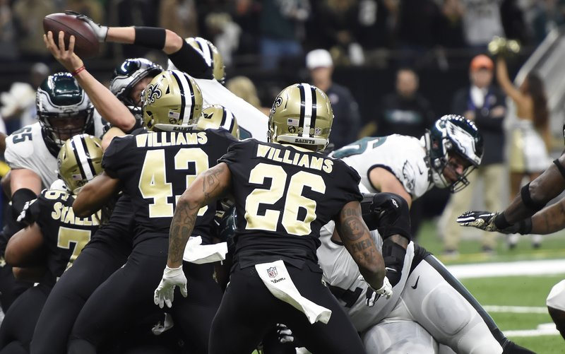 Philadelphia Eagles quarterback Nick Foles (9) leaps into the end zone for touchdown in the first half of an NFL divisional playoff football game against the Philadelphia Eagles in New Orleans, Sunday, Jan. (AP Photo/Bill Feig)