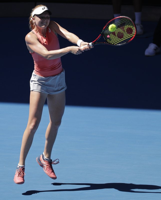 Britain's Harriet Dart makes a backhand return to Russia's Maria Sharapova during their first round match at the Australian Open tennis championships in Melbourne, Australia, Monday, Jan. (AP Photo/Aaron Favila)