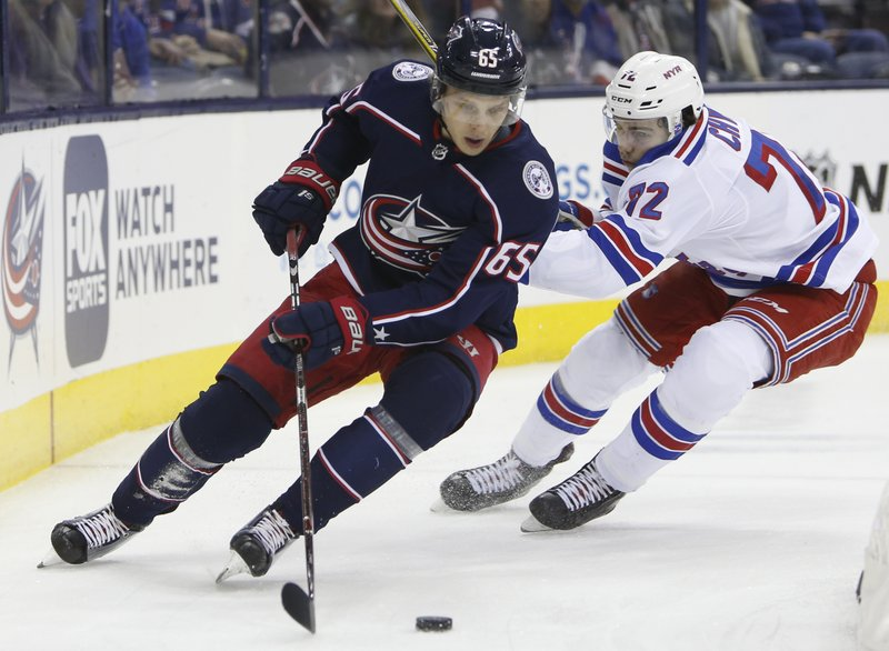 Columbus Blue Jackets' Markus Nutivaara, left, of Finland, tries to clear the puck as New York Rangers' Filip Chytil, of the Czech Republic, defends during the first period of an NHL hockey game Sunday, Jan. (AP Photo/Jay LaPrete)