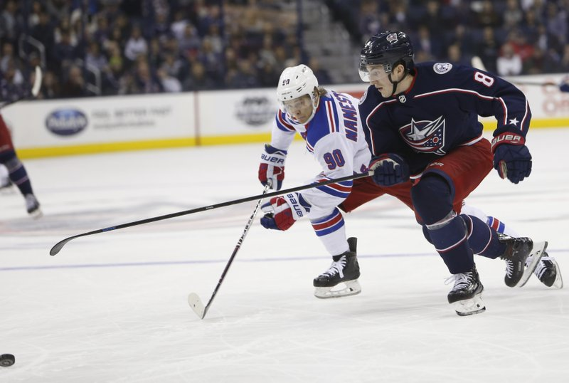 New York Rangers' Vladislav Namestnikov, left, of Russia, and Columbus Blue Jackets' Zach Werenski chase the puck during the first period of an NHL hockey game Sunday, Jan. (AP Photo/Jay LaPrete)