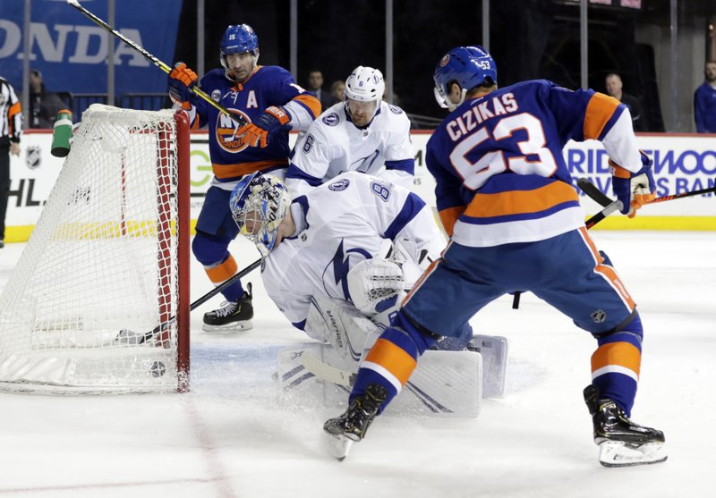 Tampa Bay Lightning goaltender Andrei Vasilevskiy (88) watches the puck shot by New York Islanders' Casey Cizikas (53) get past him for a goal during the second period of an NHL hockey game, Sunday, Jan. (AP Photo/Frank Franklin II)