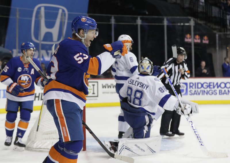 New York Islanders' Casey Cizikas (53) gestures to teammates as he celebrates shooting the puck past Tampa Bay Lightning goaltender Andrei Vasilevskiy (88) for a goal during the second period of an NHL hockey game, Sunday, Jan. (AP Photo/Frank Franklin II)