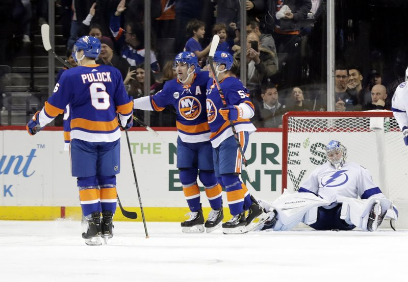 Tampa Bay Lightning goaltender Andrei Vasilevskiy, right, reacts as the New York Islanders celebrate a goal by Cal Clutterbuck during the first period of an NHL hockey game Sunday, Jan. (AP Photo/Frank Franklin II)