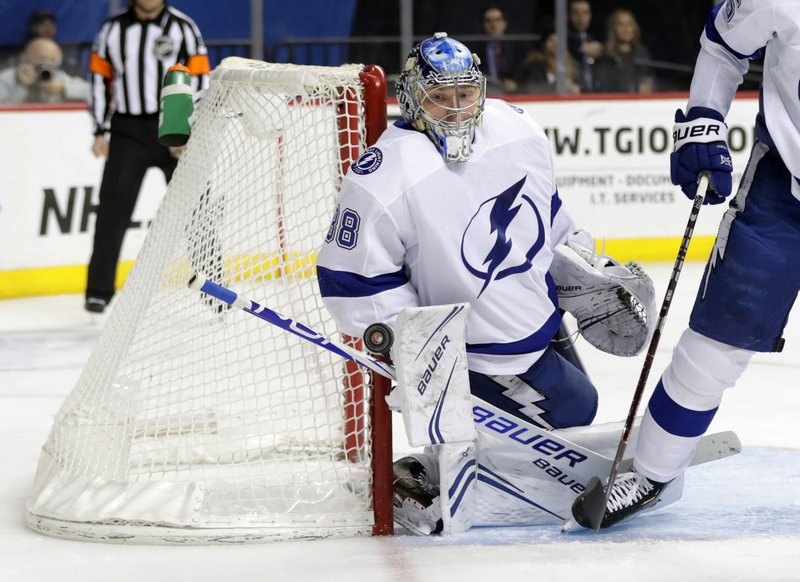 Tampa Bay Lightning goaltender Andrei Vasilevskiy (88) stops a shot on the goal during the second period of an NHL hockey game against the New York Islanders, Sunday, Jan. (AP Photo/Frank Franklin II)