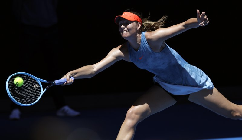Russia's Maria Sharapova reaches for a forehand return to Britain's Harriet Dart during their first round match at the Australian Open tennis championships in Melbourne, Australia, Monday, Jan. (AP Photo/Aaron Favila)