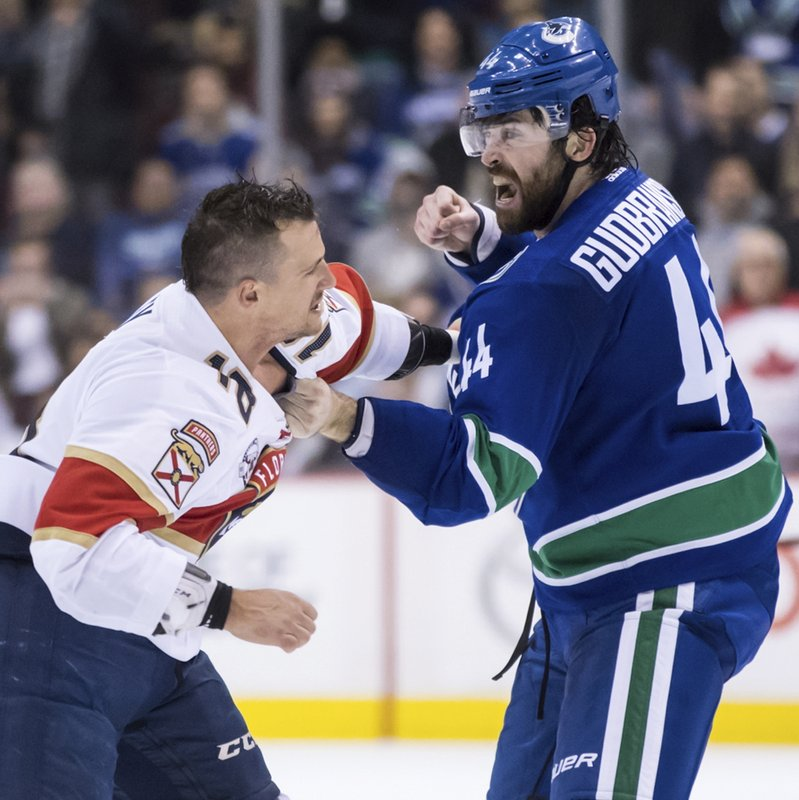 Vancouver Canucks' Erik Gudbranson, right, and Florida Panthers' Micheal Haley fight during the first period of an NHL hockey game in Vancouver, British Columbia, Sunday, Jan. (Darryl Dyck/The Canadian Press via AP)