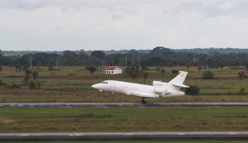 The plane carrying Italian fugitive Cesare Battisti takes off for Italy, where he will serve a life sentence, from the airport in Santa Cruz, Bolivia, Sunday, Jan. (AP Photo)