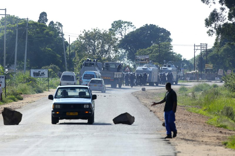 Riot police are seen on the streets during protests over the hike in fuel prices in Harare, Zimbabwe, Monday, Jan. (AP Photo/Tsvangirayi Mukwazhi)
