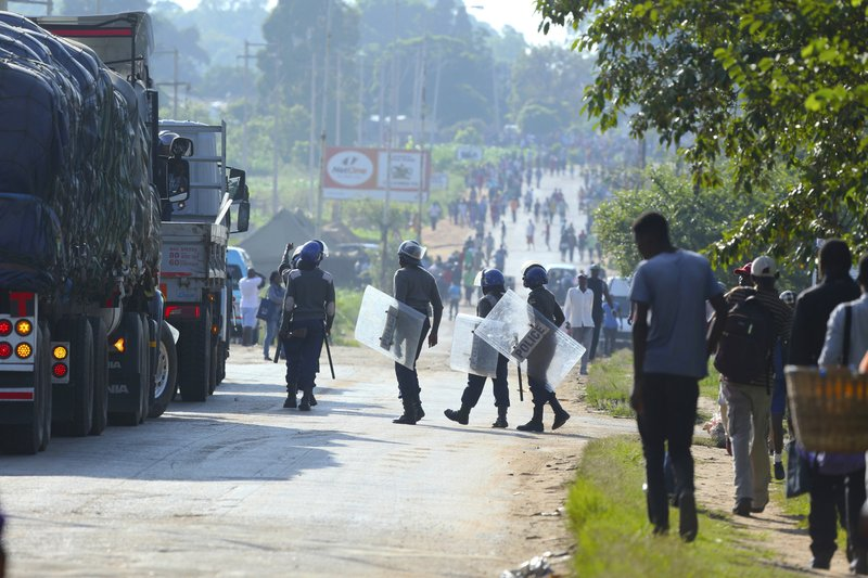 Riot police are seen on a street during a demonstration over the hike in fuel prices in Harare, Zimbabwe, Monday, Jan. (AP Photo/Tsvangirayi Mukwazhi)