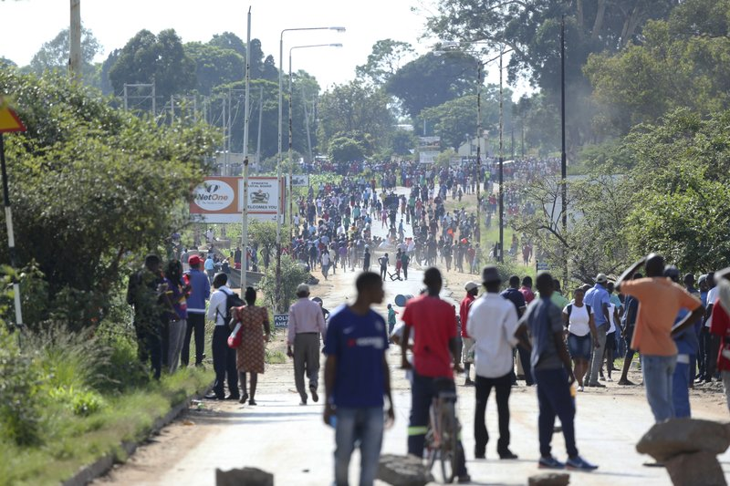 Protesters gather on a street during a demonstration over the hike in fuel prices in Harare, Zimbabwe, Monday, Jan. (AP Photo/Tsvangirayi Mukwazhi)