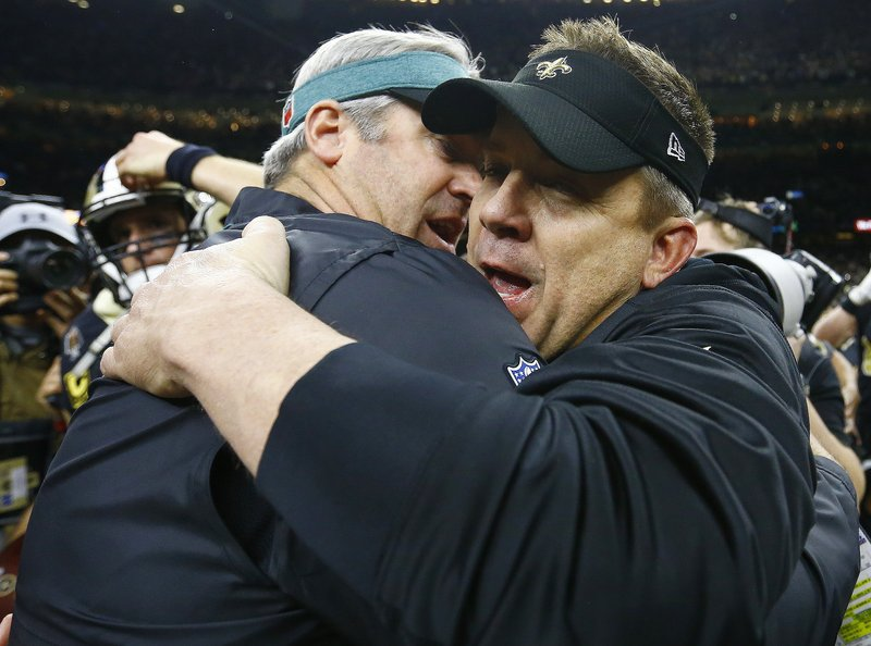 New Orleans Saints head coach Sean Payton, right, speaks with Philadelphia Eagles head coach Doug Pederson after an NFL divisional playoff football game in New Orleans, Sunday, Jan. (AP Photo/Butch Dill)