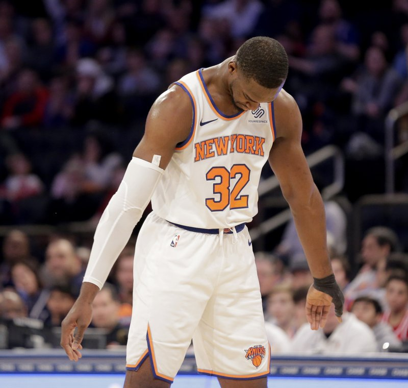 New York Knicks' Noah Vonleh reacts after being called for a foul during the first half of an NBA basketball game against the Philadelphia 76ers, Sunday, Jan. (AP Photo/Seth Wenig)