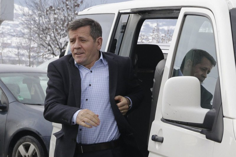 Former Kosovo Liberation Army fighter Rrustem Mustafa arrives in Adem Jashari airport, Pristina, to travel to The Hague on Sunday, Jan. (AP Photo)