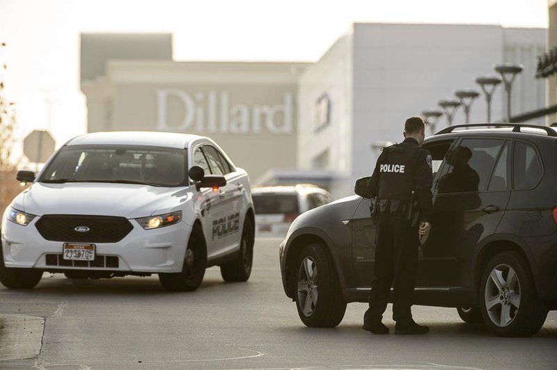 Police escort employees from Dillard's out of the Fashion Place mall after a shooting in Murray, Utah, Sunday, Jan. (Francisco Kjolseth/The Salt Lake Tribune via AP)
