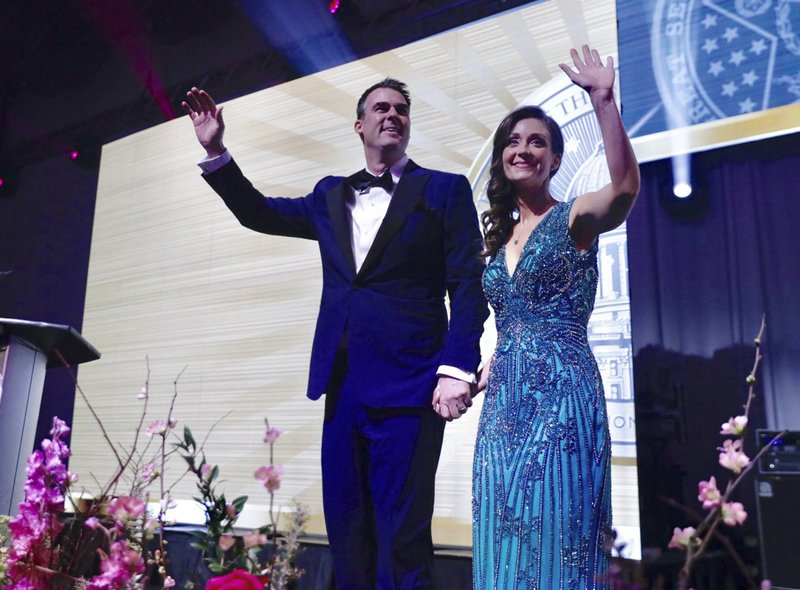 Oklahoma Republican Governor-elect Kevin Stitt and his wife Sarah arrive at the Pre-inaugural Redbud Ball at the Cox Business Center Saturday, Jan. (Mike Simons/Tulsa World via AP)