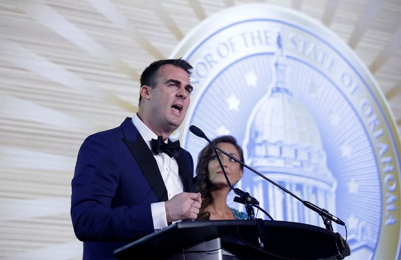 Oklahoma Republican Gov.-elect Kevin Stitt with his wife Sarah Stitt at his side speaks at his Pre-inaugural Redbud Ball at the Cox Business Center Saturday, Jan. (Mike Simons/Tulsa World via AP)