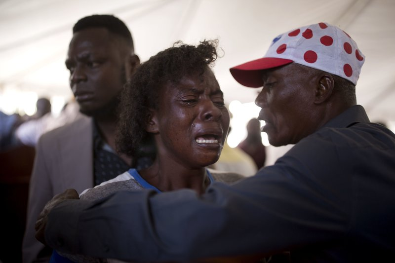In this Dec. 13, 2018 photo, Morelle Lendor, who survived the La Saline massacre and lost a friend, cries during a memorial ceremony for the victims in Port-au-Prince, Haiti. (AP Photo/Dieu Nalio Chery)