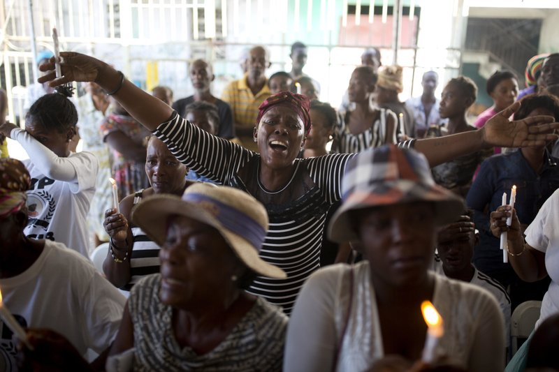 In this Dec. 13, 2018 photo, Makileine Derosier cries out for justice during a memorial ceremony for the victims of the La Saline massacre in Port-au-Prince, Haiti. (AP Photo/Dieu Nalio Chery)