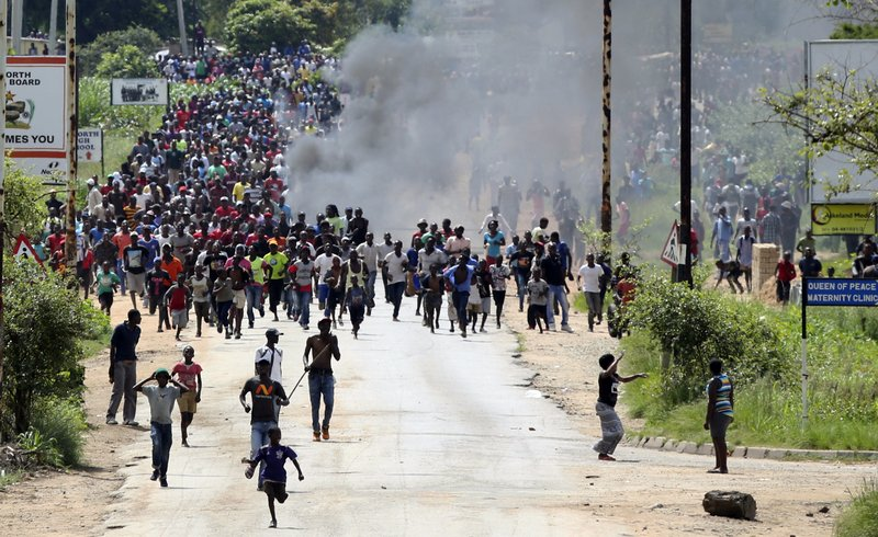Protestors gather on the streets during demonstrations over the hike in fuel prices in Harare, Zimbabwe, Monday, Jan. (AP Photo/Tsvangirayi Mukwazhi)
