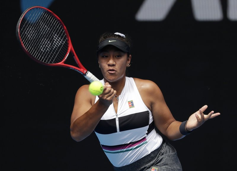 Australia's Destanee Aiava hits a forehand return to United States' Madison Keys during their first round match at the Australian Open tennis championships in Melbourne, Australia, Tuesday, Jan. (AP Photo/Kin Cheung)