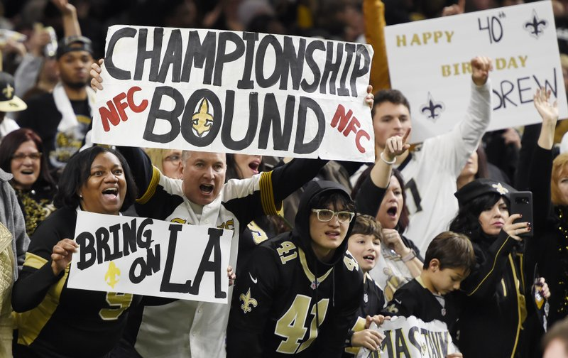 New Orleans Saints cheer in the second half of an NFL divisional playoff football game against the Philadelphia Eagles in New Orleans, Sunday, Jan. (AP Photo/Bill Feig)