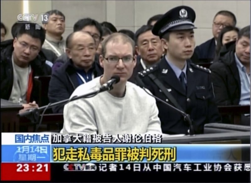 In this image taken from a video footage run by China's CCTV, Canadian Robert Lloyd Schellenberg attends his retrial at the Dalian Intermediate People's Court in Dalian, northeastern China's Liaoning province on Monday, Jan. (CCTV via AP)