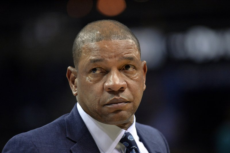 FILE - In this Dec. 5, 2018 file photo, Los Angeles Clippers head coach Doc Rivers stands on the court in the first half of an NBA basketball game against the Memphis Grizzlies in Memphis, Tenn. (AP Photo/Brandon Dill, File)